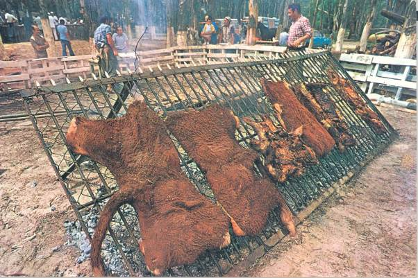 Asado con cuero (barbecue with hide) now rare, was still quite common at the time I worked as a field veterinarian in Uruguay.