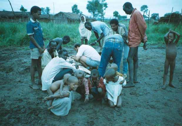 Collecting ticks from cattle in Gambela, Ethiopia.
