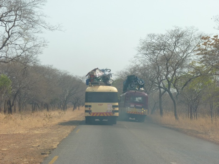 buses overtaking small
