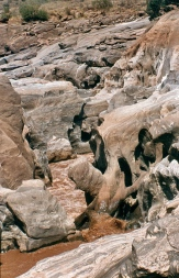The Galana river going through the rocks at Lugard falls.